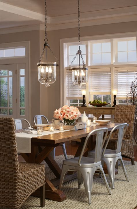 Traditional Dining Room Features An Iron Cage Chandelier Illuminating A Whitewashed Farmhouse Table Lined With St