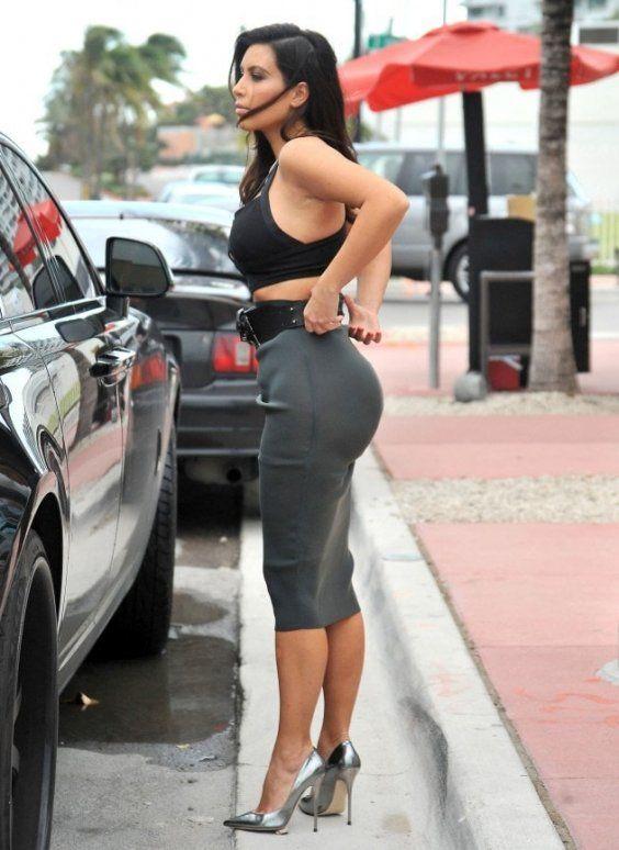 4661121948827 Kim Kardashian works a pencil skirt and belt to highlight her figure.