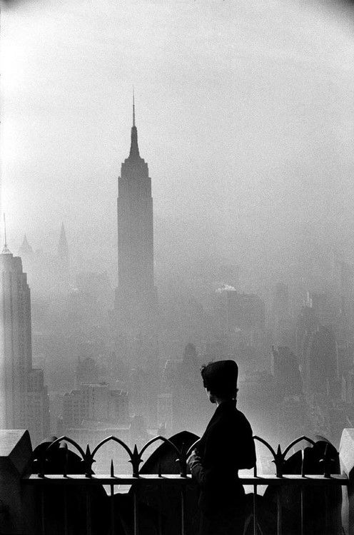 Empire State Building in the background.   New York CIty by Elliott Erwitt, 1955