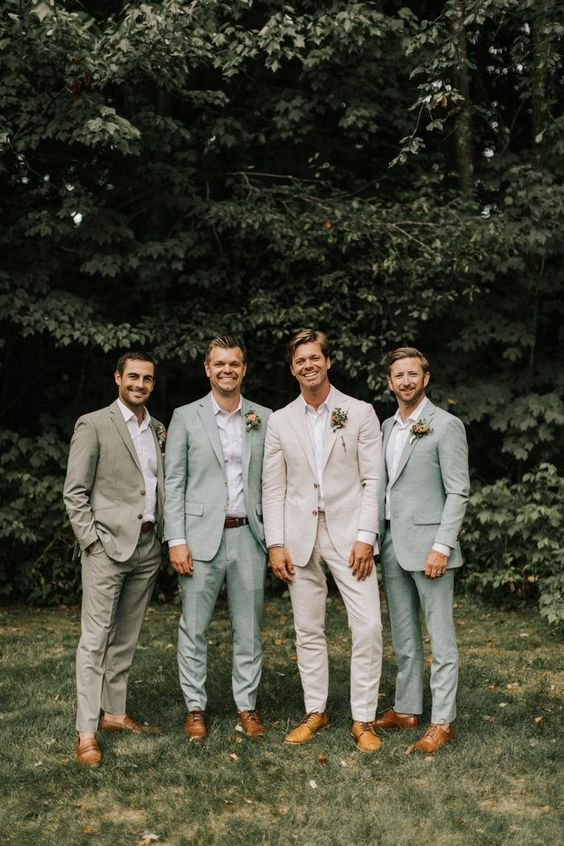 We are loving the groomsmen's pastel and neutral colored suits! | Image by Jamie Mercurio Photography