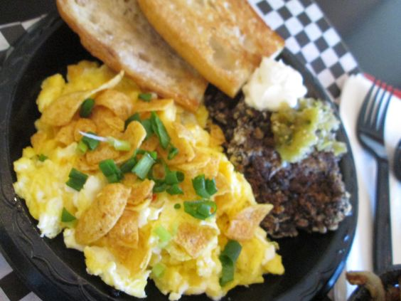 BLACK BEAN CAKES & SCRAMBLED EGGS topped with corn chips, tomatillo ...