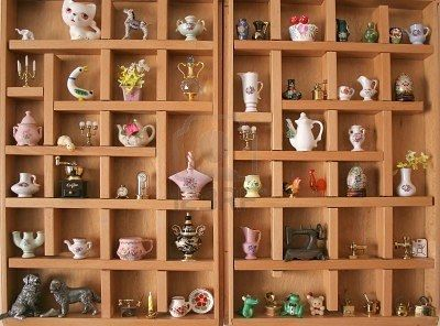 I absolutely adore miniatures...in shadowboxes.  The little vases and pitchers are the most fun!