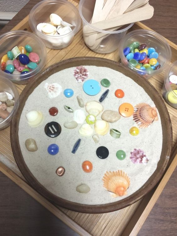 A creative way to work with kids and adults combining mindfulness, mandalas and sandtray therapy: