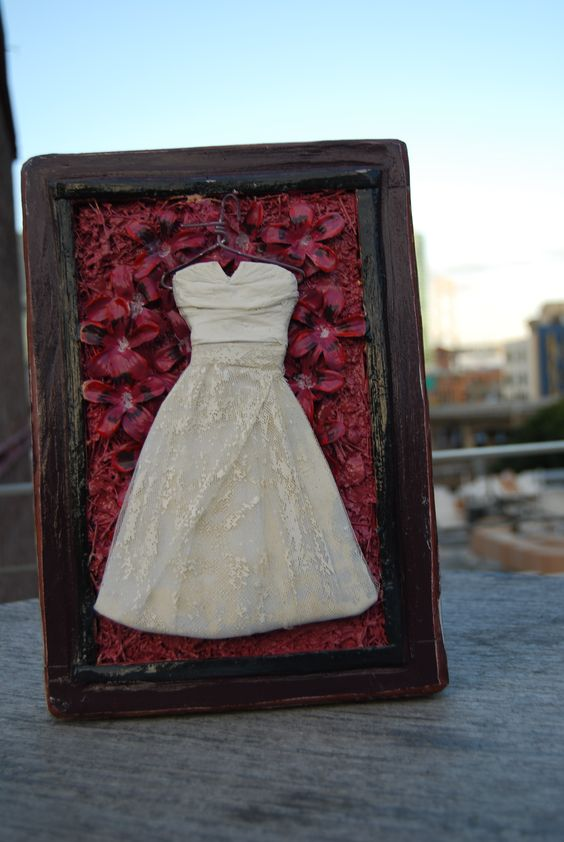wedding dress recreated in mix media art piece. made from recycled materials. love it!