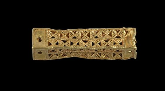 Oblong gold ornament of square cross-section, sides consisting of openwork panels.