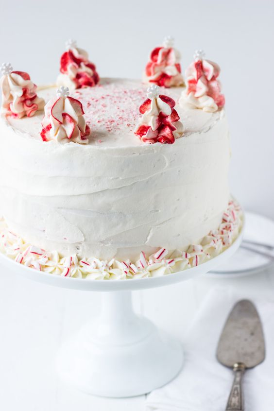 Peppermint White Chocolate Cake - a moist white chocolate cake layered in a cool peppermint whipped frosting! via @zmansaray