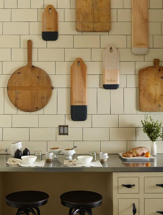 many things to love. 1. subway tile with a vertical section to break it up 2. The artfully displayed and beautifully dipped milk paint cutting boards 3. zinc counter tops: