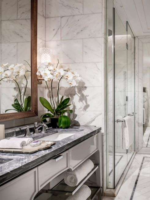 Modern Bathroom With Grey Marble Counters White Orchids In Vase Glass Shower Luxury Hotel Room Bathroom Design Hotels Room Luxury hotel bathroom in jakarta