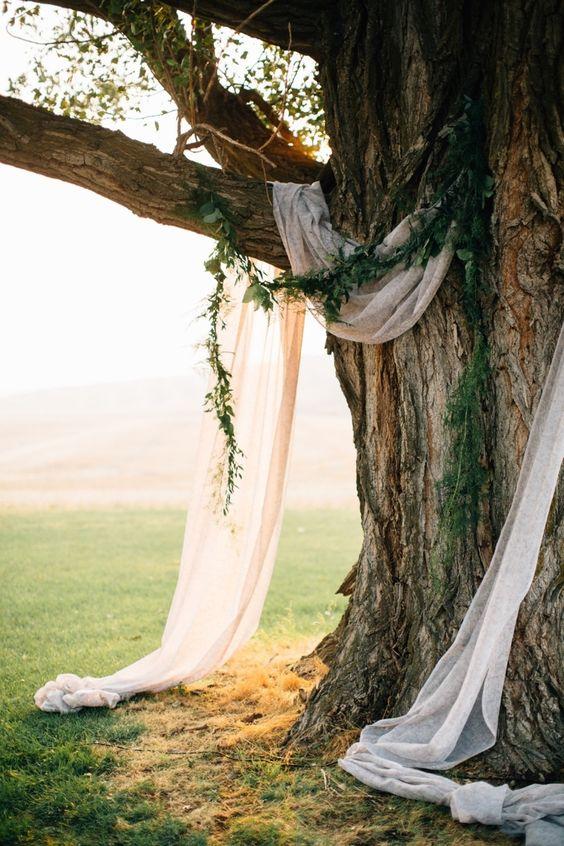 budget backyard wedding ceremony decorations draped linen altar