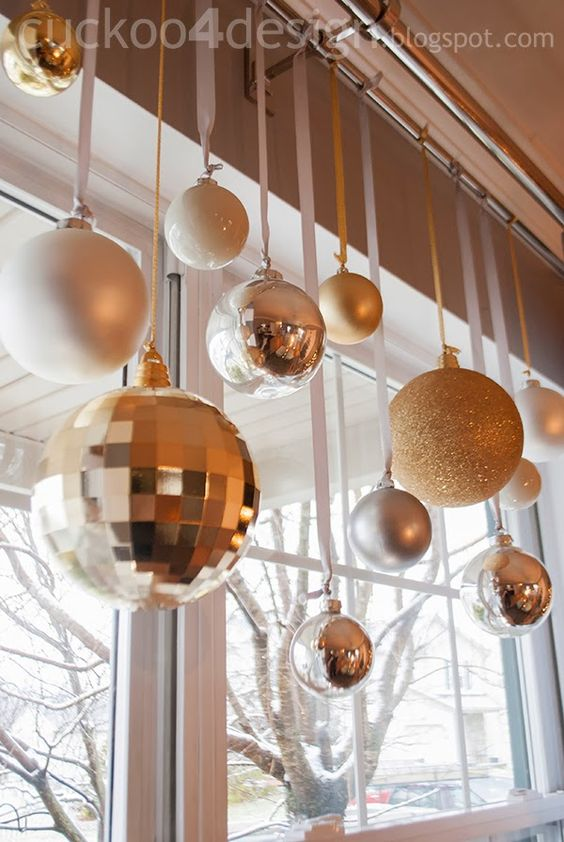 Christmas balls on ribbon hanging from curtain rod - various heights ...