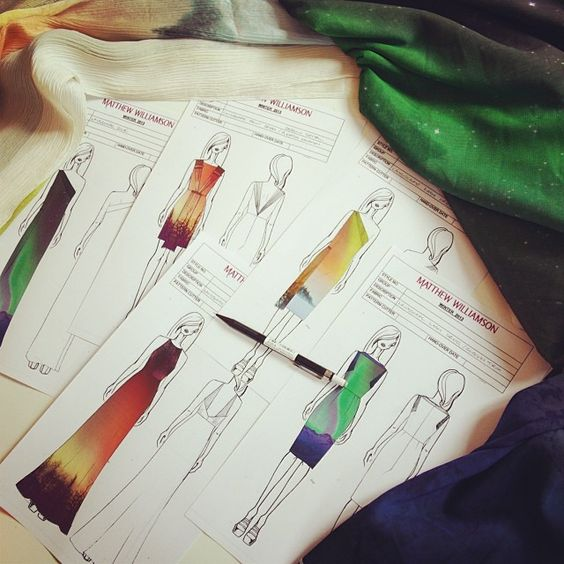"""Sketches in Matthew Williamson's design studio of dresses and gowns in bright greens, blues, reds and yellows, inspired by the northern lights. """"Our Northern Lights inspired dresses for winter #inspiration #studio """""""