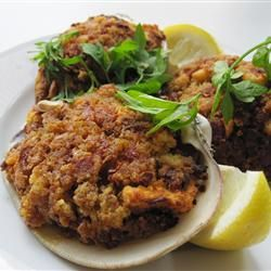 Large clam shells are stuffed with chopped clams, spicy sausage and bread stuffing in this easy variation on an East coast classic.