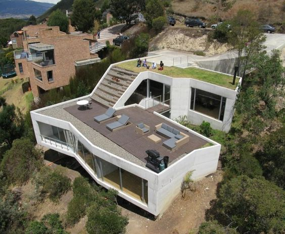Steep hillside house plans house on a steep hill green for Home designs on sloped land