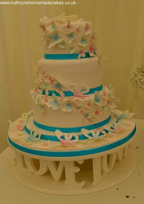 3 Tier wedding cake with pink and turquoise  butterflies cascade