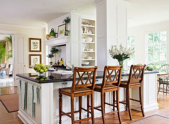 A big island with barstools is accommodating for everyday, casual dining, while a more formal space is just around the corner. - Traditional Home ® / Photo: Emily Minton Redfield / Design: Joseph Minton: