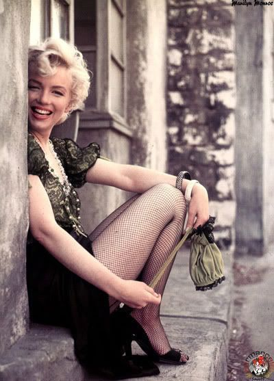 Marilyn, smiling in a doorway.