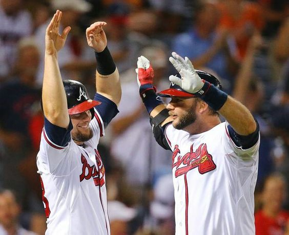 Braves A.J. Pierzynski (right) is greeted at home by Chris Johnson as he hits a 2-RBI home run to tie the game 7-7 with the Giants during the 9th inning in a baseball game to send it to extra innings on Monday, August 3, 2015, in Atlanta. Curtis Compton / ccompton@ajc.com