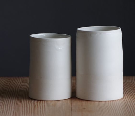 white porcelain cylinders