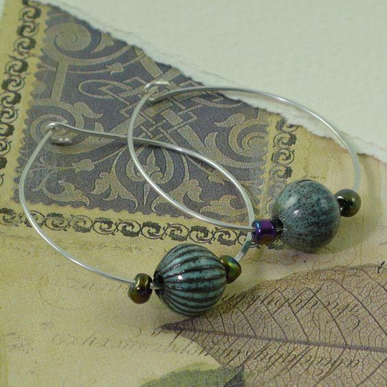 Handmade Powder Blue Enamel Bead and Silver Hoop Earrings. $28.00, via Etsy.