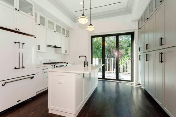 Gorgeous duplex in a stunning brownstone for rent  3 bedroom / 3 bathroom on a quiet and quaint tree lined block   Extensively renovated and elegantly restored  Exquisite original details: high ceilings with crown moldings, oak hardwood floors, decorative fireplace mantles.   Open Chef's Kitchen features: generous center island, stainless steel appliances, custom European cabinetry, and a stunning wall of folding glass doors (floor to ceiling) that leads to the outdoor area   Bathroom ...