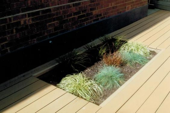 Cladco WPC Decking Boards in Teak.  www.wpc-decking.co.uk