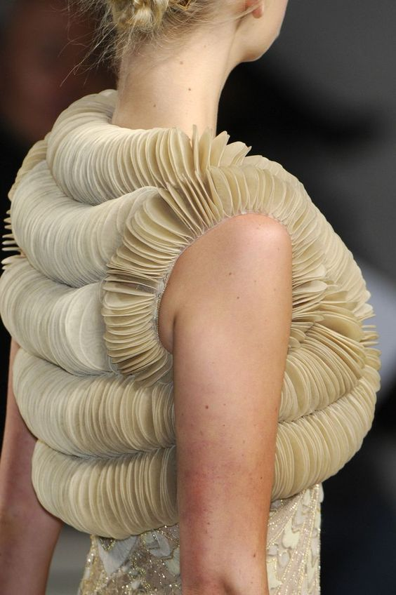 Amazing use of fabric manipulation for fashion design: bolero with 3D construct made using folded fabric discs to create a dimensional patterned structure // Valentino