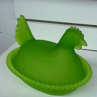Lime green depression glass hen on nest.