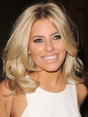 Mid length blonde hair Mollie King
