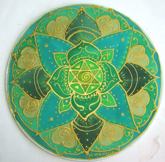 The Heart Chakra mandala is painted in greens and outlined ...