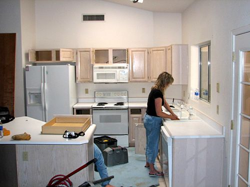 L shaped kitchen with stove and refrigerator next to each other ...