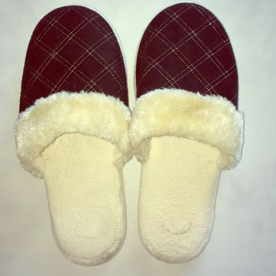 House slippers NWOT Comfortable & soft house slippers made with all man made materials and contains faux fur.  Brand new without tags Shoes Slippers
