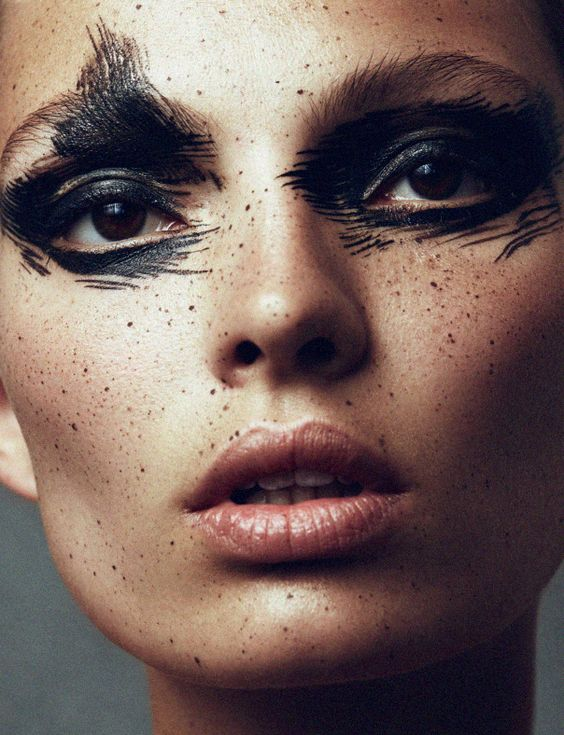 Using liquid eyeliner like paint and incorporating into areas other than the eyes.