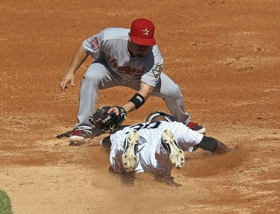 CHICAGO, IL - JUNE 09: Jose Altuve #27 of the Houston Astros tags out Alejandro De Aza #30 of the Chicago White Sox trying to steal second base at U.S. Cellular Field on June 9, 2012 in Chicago, Illinois. (Photo by Jonathan Daniel/Getty Images)  game 59