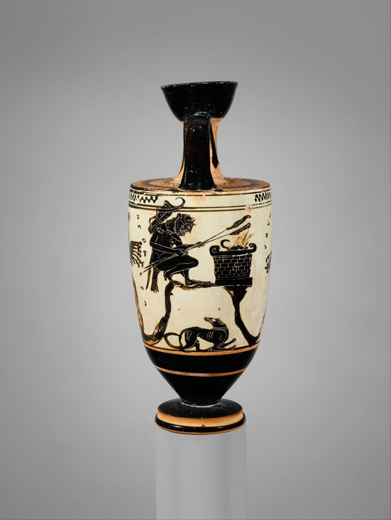 Terracotta lekythos (oil flask) Attributed to the Sappho Painter Period: Archaic Date: ca. 500 B.C. Culture: Greek, Attic Medium: Terracotta; black-figure, white-ground  Dimensions: H. 6 13/16 in. (17.3 cm); diameter 2 13/16 in. (7.2 cm) | Helios (the Sun) rises in his quadriga (4-horse chariot); above, Nyx (Night) driving away to the left and Eos (the goddess of dawn) to the right; Herakles offering sacrifice at altar. | The Metropolitan Museum of Art