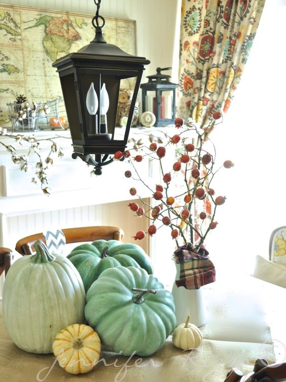 Love this Fall dining table display. The lantern with the blue and cream pumpkins are a perfect combination