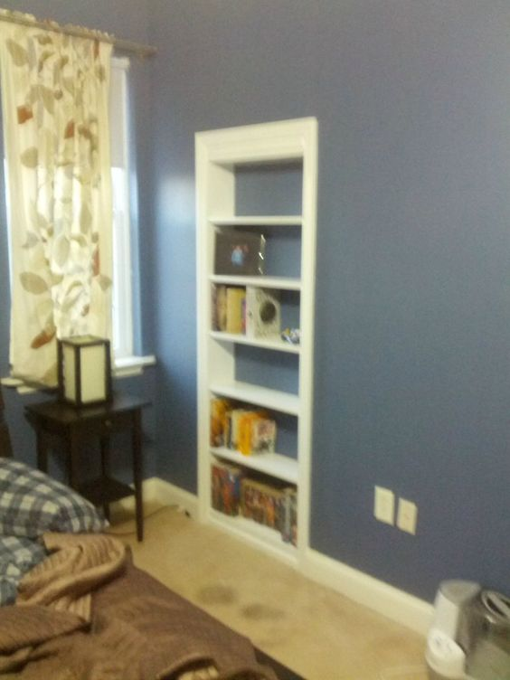 Storage space hidden behind a hinged bookcase projects for Secret storage bookcase