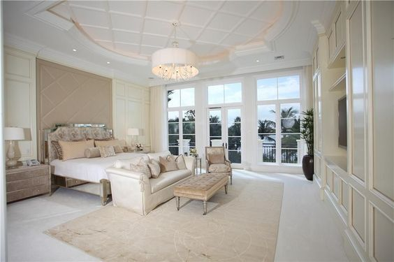 Contemporary Guest Bedroom with Transom window, Built-in bookshelf, Chandelier…