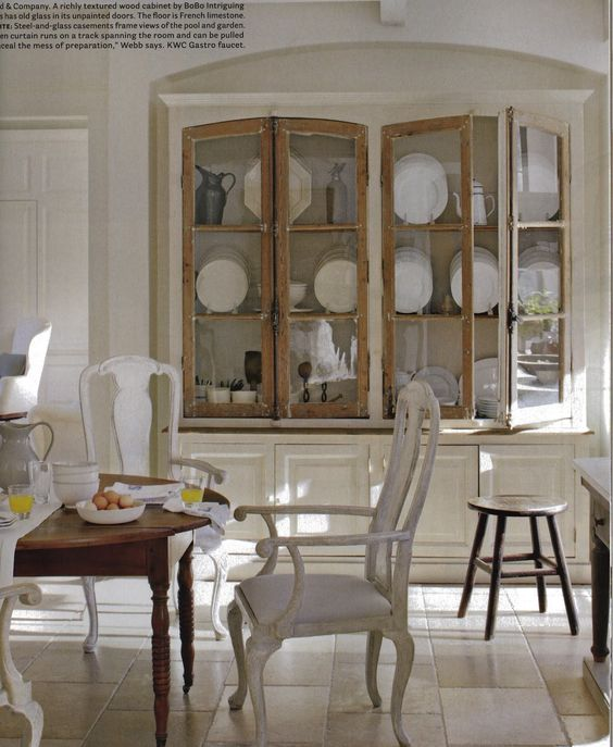 Beautiful wood cabinets from BoBo Intriguing Objects, French limestone floor  - Atlanta Home by Beth Webb