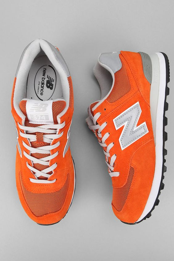 New Balance 574 Sneaker... Cute! I would litterally live in these shoes! I mean seriously they're orange!!! :D