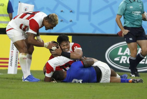 Japan S Timothy Lafaele Is Congratulated By Teammates After Scoring A Try During The Rugby World Cup Pool A Game At City Of Toyota Japan Rugby World Cup Rugby