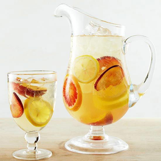 To make this Sweet Honey White Sangria we've combined brandy, honey, sparkling wine and citrus flavors. More fruity sangria recipes: http://www.bhg.com/recipes/drinks/wine-cocktails/sangria-recipes/?socsrc=bhgpin032912whitesangria