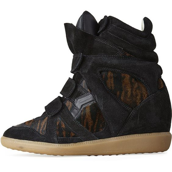 The designer's famed high-top sneaker, elevated in the theme of the season with internal wedge heel & tiger printed pony hair accents. Rounded, perforated. 3 v…