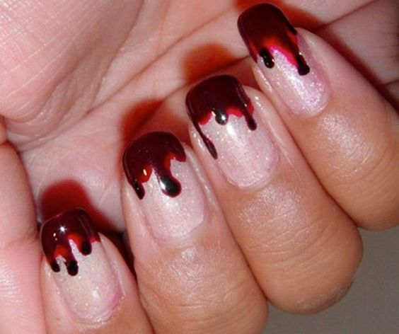 blood nails! id actually do this from the cuticle down for a creepier effect. but thats just me ;)