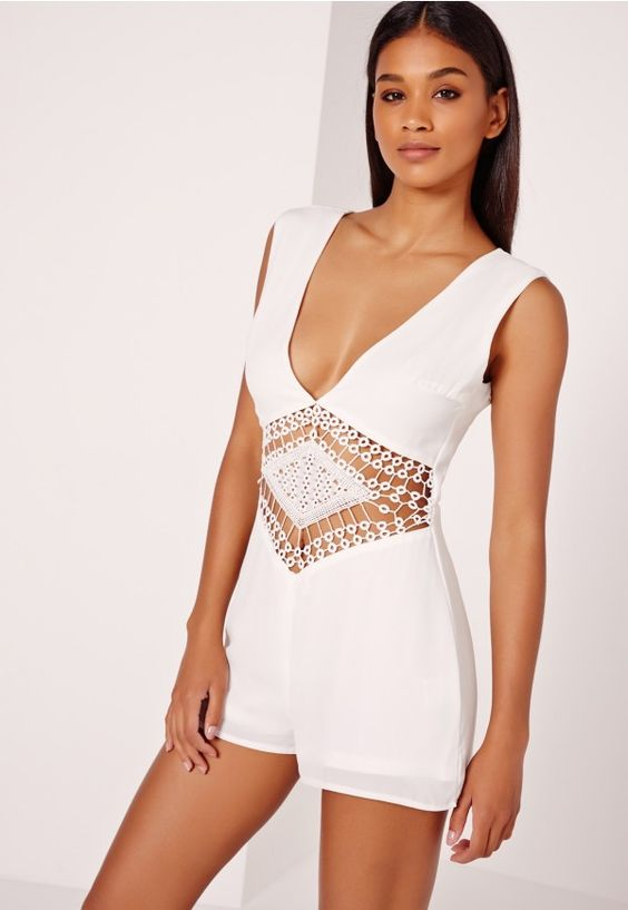For a playsuit that packs a serious punch, you need this black beauty in your life, seriously. This playful party piece will ensure all eyes are on you, whatever the occasion. With lace trim waist detail and back zip fastening, wear with he...