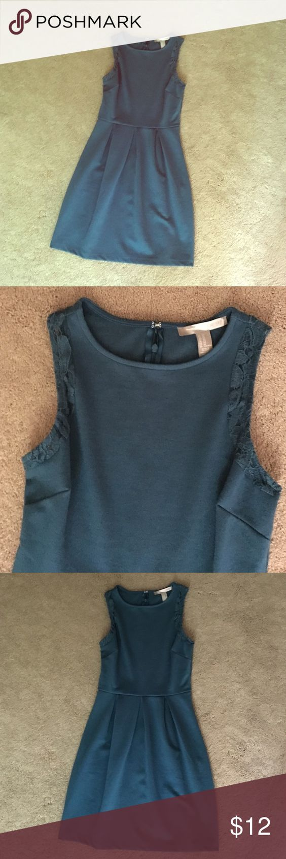 Never worn Forever 21 teal dress A tank top dress, tight on top with a straight, looser skirt. Some lace around the arm holes, zipper and hook on the back. Thicker, nice material, great for dressing up or down! Forever 21 Dresses