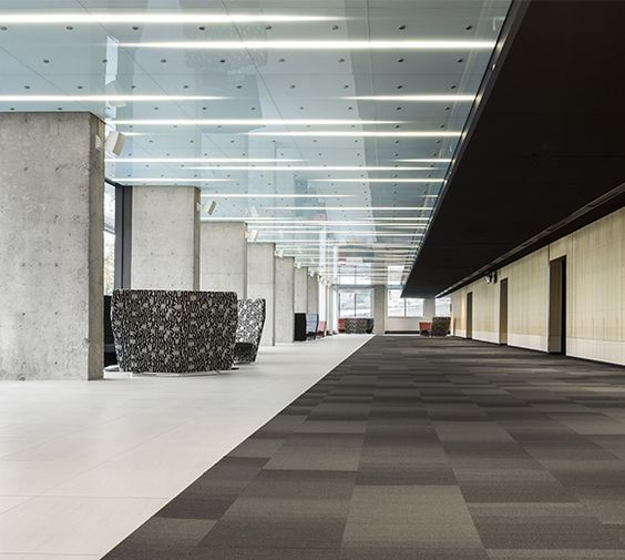 LEMAYMICHAUD | Quebec | Conference Hall | Architecture | Design | Seating | Carpet | Windows | Natural Light | Black | Gray | Red | White | Concrete