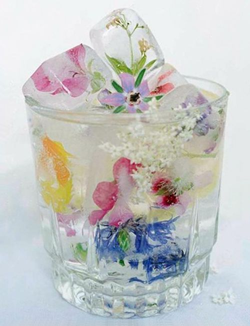 Floral Ice cubes ~ To suspend flowers in the cubes, work in layers: Fill an ice tray (one that makes large cubes so the ice will last longer) a quarter of the way with water, add flowers facing down, and freeze. Add more water to fill halfway, and freeze. Fill to the top, and freeze again