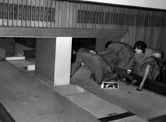 Beatlemania, fans try to sneak into customs via baggage conveyor belt. 1964: Beatlemania - In Focus - The Atlantic