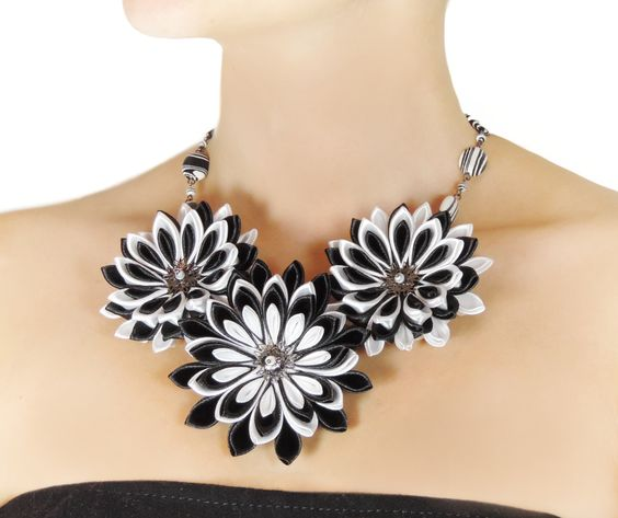 Tsumami kanzashi inspired necklace with three large, black  white flowers. This is part