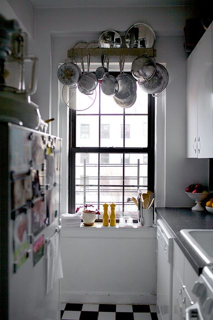 pot rack over window! if smitten kitchen does it, it must ...